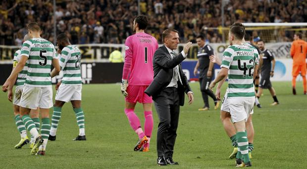 Celtic's Callum McGregor with manager Brendan Rodgers after the match. Photo: REUTERS/Alkis Konstantinidis