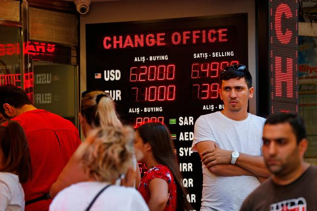 The Turkish lira firmed after the central bank had pledged on Monday to provide liquidity in response to the meltdown which has unsettled global markets. (AP Photo/Lefteris Pitarakis)