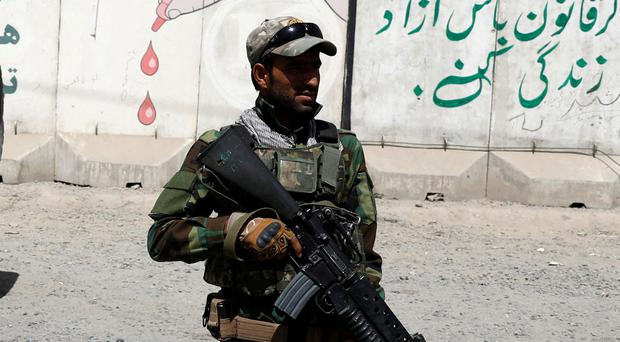 An Afghan Army soldier keeps watch at a checkpoint in Ghazni. Photo: Mohammad Ismail