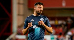 Bury's Eoghan O'Connell stands dejected after seeing his deciding penalty kick saved by Nottingham Forest goalkeeper Luke Steele in the shoot out during the Carabao Cup, First Round match at the City Ground, Nottingham.