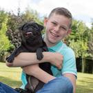 Jamie McMahon with his dog Coco at home in Emo, Co. Laois. Photo: Alf Harvey.