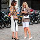 Funda Christophersen wearing checked Burberry button shirt and, white midi skirt, black heels, Prada sunglasses seen outside Cathrine Hammel during Oslo Runway SS19 on August 14, 2018 in Oslo, Norway. (Photo by Christian Vierig/Getty Images)
