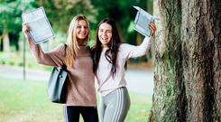 Emma Spillane (431 points), who wants to do international business in UL, and Tarrika Reily (451), who wants to do law in Galway, with their results from Villiers School in Limerick. Photo: Brian Arthur