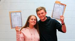 Students and twins Aidan and Kate Pepper from Kilbarrack who got Leaving Cert Results at Pobalscoil Neasain, Baldoyle, Dublin. Photo: Gareth Chaney Collins