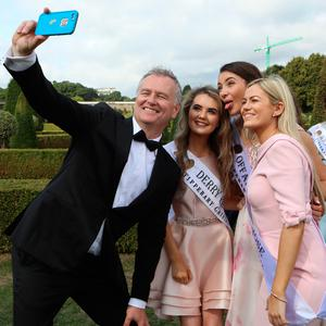 15/8/2018 Presenter Daithi O Se poses with the 2018 Rose of Tralee contestants L-R: Derry (Emer McKenna), Offaly (Katie Kehoe) and Tyrone (Ellen Campbell) at the Gardens in Kilmainham Hospital in Dublin yesterday(Wed) Pic: Collins
