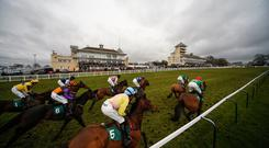 A general view as runners pass the grandstands at Towcester racecourse
