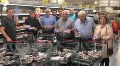 IFA pigmeat farmers highlighting the amount of non Bord Bia quality assured pigmeat products in Supervalu. Pic: IFA