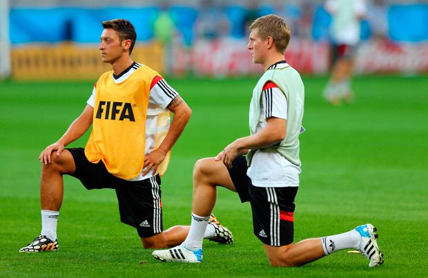 BELO HORIZONTE, BRAZIL - JULY 07: Toni Kroos (R) of Germany stretches during the German national team training at Estadio Mineirao on July 7, 2014 in Belo Horizonte, Brazil. (Photo by Martin Rose/Getty Images)