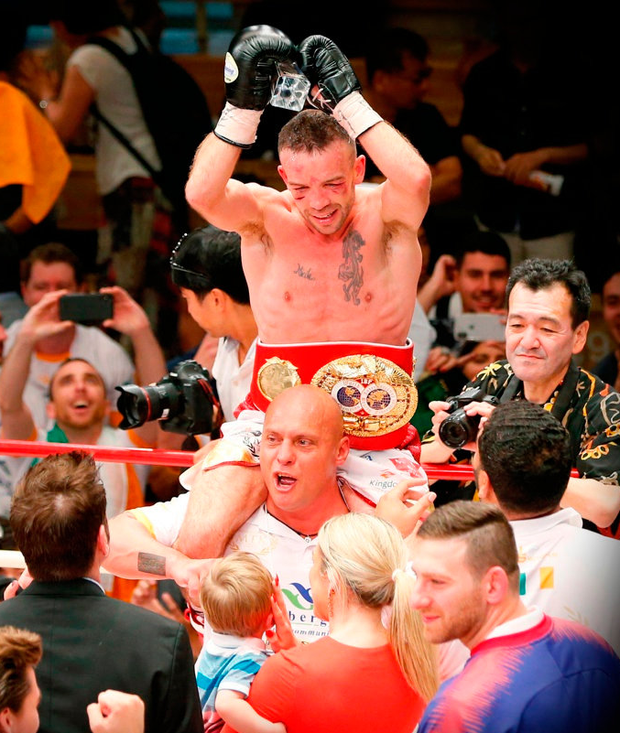 WORLD CROWN: TJ Doheny celebrates after beating Japanese champion Ryosuke Iwasa in their IBF world super bantamweight title match in Tokyo. Photo: AP