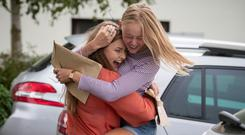 Muireann Twomey and Hillary Balding celebrate their results at Kilkenny College. Photo: Dylan Vaughan
