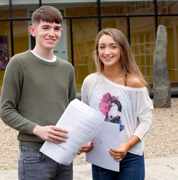 Cian O'Dwyer and Cara O'Connor with their Leaving Cert results at Gorey Community College. Photo: Tony Gavin