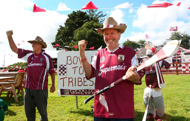 Galway supporter Lar Kelly, right, and his brother-in-law Martin Duane outside his house in Laurencetown. Photo: Damien Eagers