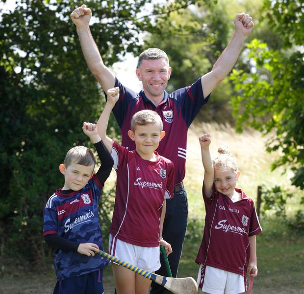 Former Galway hurler Niall Hayes with his children Faye (4), Dara (8) and Cian (6). Photo: Damien Eagers