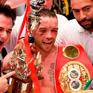 Ireland's TJ Doheny celebrates with his belt after beating Japanese champion Ryosuke Iwasa in their IBF world super bantamweight boxing title fight in Tokyo. Photo: Getty Images