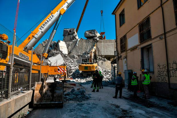 Machines have continued to sift through the bridge wreckage in the hope of finding survivors. Photo: Piero Cruciatti/Getty Images