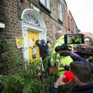 Agents of the plaintiff enter the house which had been occupied by a number of protesters at 35 Summerhill Parade. Photo: Tony Gavin