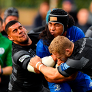 Leinster's Joe Tomane is tackled by Newcastle Falcons' Josh Matavesi (left) and Alex Tait. Photo: Sportsfile
