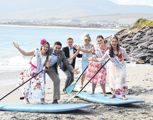 Toronto Rose Carly McGrath, escorts Patrick Cashman and Thomas Roche, Melbourne Rose Suzie Jackson, Yorkshire Rose Alana Gallagher and Abu Dhabi Rose Sara Kate Mangan on surf boards in the Maharees, Co Kerry. Photo: Domnick Walsh