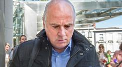 Former Anglo Irish CEO David Drumm leaves the Criminal Courts of Justice after his guilty verdict. Photo: Tony Gavin