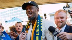 Eight-time Olympic champion Usain Bolt reacts as he arrives at Sydney Airport ahead of his trial at the Central Coast Mariners soccer club in Australia, August 18, 2018. AAP/Erik Anderson/via REUTERS