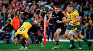 Australia's Israel Folau is tip tackled by New Zealand's Waisake Naholo