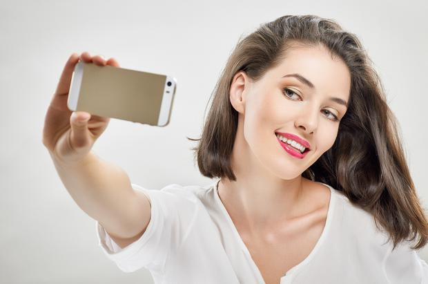 It is far more common for men to die trying to take a selfie than women. (Stock image)
