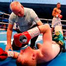 Paddy Barnes is counted down by the referee after being knocked down by Cristofer Rosales. Action Images via Reuters/Lee Smith