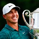 Brooks Koepka holds the Wanamaker Trophy after he won the PGA Championship at Bellerive last Sunday. Photo: AP