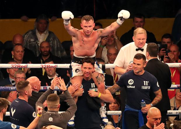 Carl Frampton celebrates victory against Luke Jackson after their WBO Interim Featherweight title fight at Windsor Park, Belfast. PRESS ASSOCIATION Photo. Picture date: Saturday August 18, 2018. See PA story BOXING Belfast. Photo credit should read: Niall Carson/PA Wire