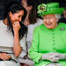Meghan and Queen Elizabeth share a joke. Picture: Getty