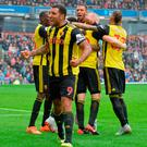 Watford's Troy Deeney celebrates after Will Hughes (background) scores his side's third goal