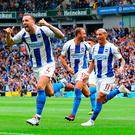 Shane Duffy (left) celebrates scoring his side's second goal