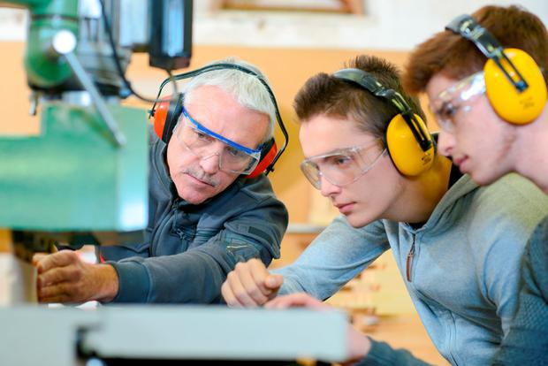 Apprenticeships will be familiar to many and traditionally have been the route to skilled occupations in a variety of industries and sectors, such as construction, engineering, motor and electrical. Stock image