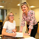 Aoife Ní Raithilligh (left), from Inchicore in Dublin, gets help from Sailí Ní Dhroighneáin at a class for aspiring teachers at Maynooth University, which is introducing a new course for disadvantaged students to help them get into teaching. Photo: Damien Eagers