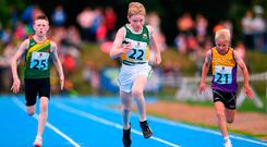 Robert Carney from Offaly (centre) in the U12 Boys 100m. Photos: Sportsfile