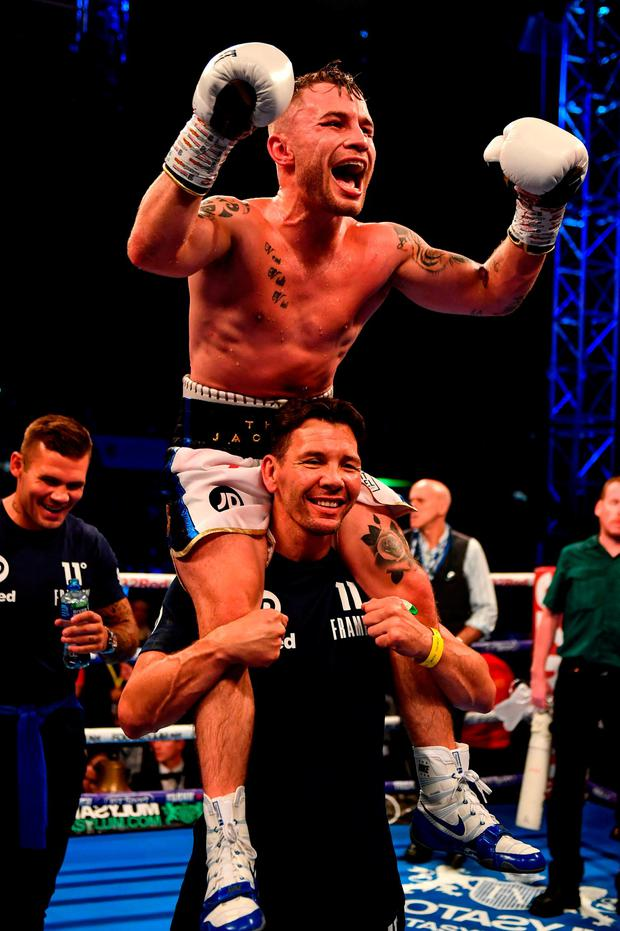 Carl Frampton celebrates his victory against Luke Jackson with coach Nigel Travis. Photo: Ramsey Cardy/Sportsfile