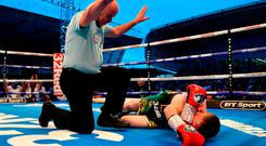 Paddy Barnes is counted out by the referee. Photo: Ramsey Cardy/Sportsfile