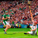 Shane Dowling shoots past Galway's Fearghal Flannery to score Limerick's third goal during yesterday's All-Ireland SHC final. Photo: Seb Daly/Sportsfile