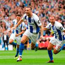Glenn Murray rushes to join in as Shane Duffy celebrates after scoring Brighton's second goal. Photo: Mike Hewitt/Getty Images