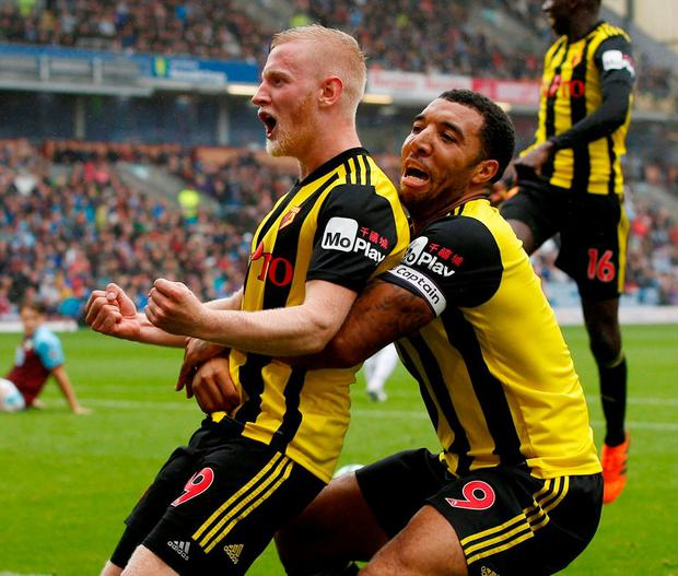 Watford's Will Hughes celebrates scoring their third goal with Troy Deeney. Photo: Andrew Yates/Reuters