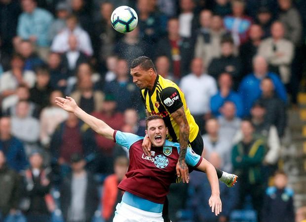 Burnley's Chris Wood in action with Watford's Jose Holebas. Photo: Ed Sykes/Action Images via Reuters