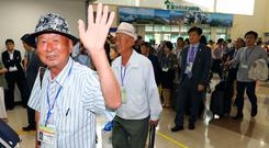 South Koreans leave for North Korea to take part in family reunions with their North Korean family members at the customs, immigration and quarantine (CIQ) office, in Goseong, South Korea (Korea Pool/Yonhap via AP)