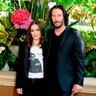 Winona Ryder (L) and Keanu Reeves attend a photo call for Regatta's