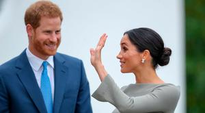 Britain's Prince Harry and wife Meghan, Duke and Duchess of Sussex make a courtesy call at the Presidential mansion on the second day of their visit in Dublin on July 11, 2018. (Photo by MAXWELLS / various sources / AFP)