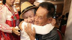 South Korean Lee Keum-seom, 92, left, weeps as she meets with her North Korean son Ri Sang Chol, 71, during the Separated Family Reunion Meeting (Korea Pool Photo via AP)