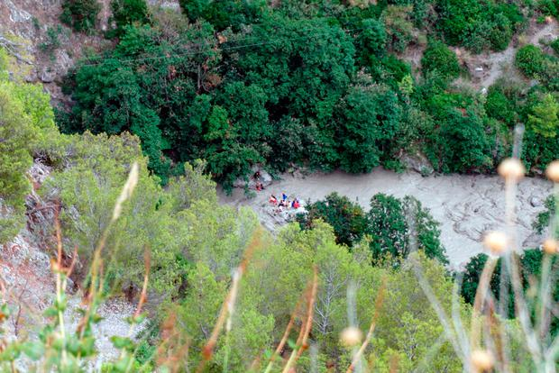 Ten dead as flash flood hits hikers in gorge in southern Italy