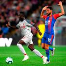 Naby Keita of Liverpool goes past Andros Townsend of Crystal Palace