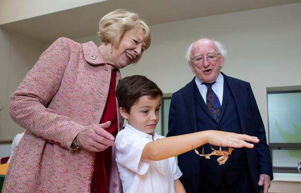 President Michael D and Sabina Higgins with Alfie Conroy (7) who is holding a stick insect at the official opening of the new Discovery and Learning Centre at Dublin Zoo. Photo: Patrick Bolger