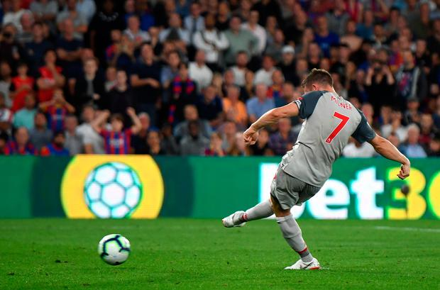 James Milner of Liverpool scores his sides first goal from the penalty spot. Photo: Getty Images