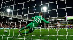 James Milner scores from the penalty spot at Selhurst Park. Photo: Reuters